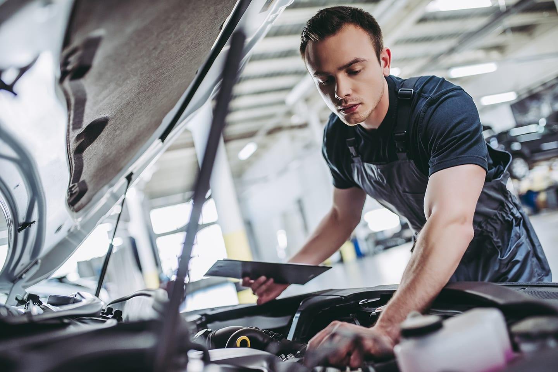 mechanic looking under hood in belleville illinois